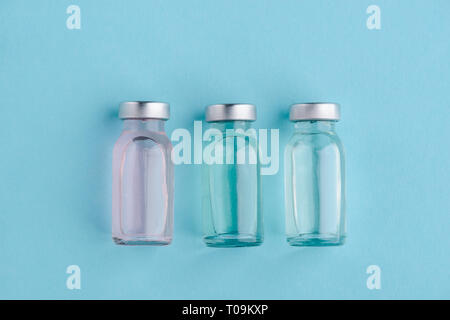 Three vials of different medicines - Stock Photo
