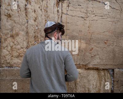 Jerusalem, Israel, 28 December 2018. Young man praying at the Western wall. - Stock Photo