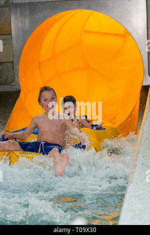 two boys comming from from water slide - Stock Photo