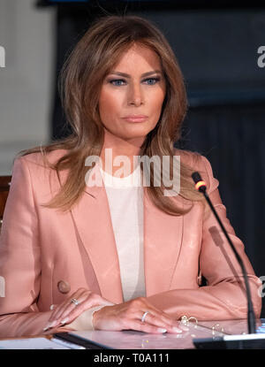 First lady Melania Trump hosts a meeting of the Interagency Working Group on Youth Programs in the State Dining Room of the White House in Washington, DC on Monday, March 18, 2019. The group was originally established under former United States President George W. Bush and is part of an effort to align the First Lady's 'Be Best' initiative with the working group. Credit: Ron Sachs/CNP /MediaPunch - Stock Photo