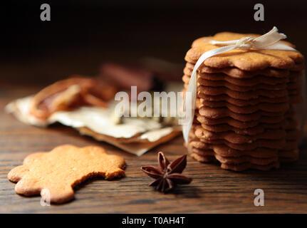 Homemade cookies on dark rustic wooden table, copy space. Healthy vegan wholegrain cookies. - Stock Photo