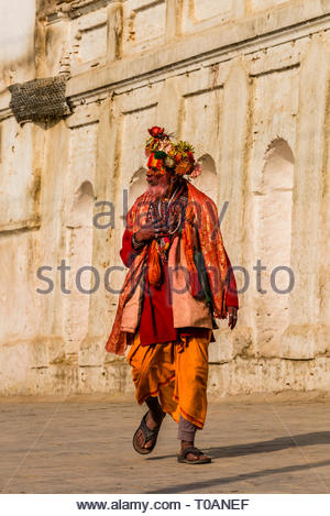 A sadhu (Holy man) at the Pashupatinath Temple, a Hindu temple along the Bagmati River in Kathmandu, Nepal. The Bagmati is equally as sacred to Nepale - Stock Photo
