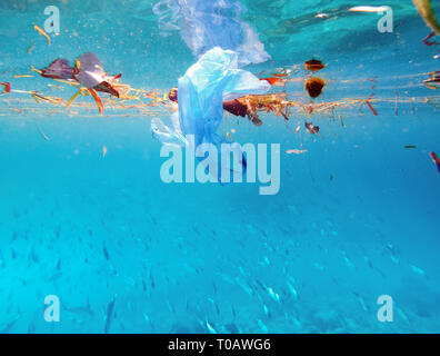 plastic bags are floating on surface of marine environment, which is major source of marine pollution - Stock Photo