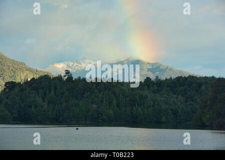 Rainbow over Queulat National Park and Puyuhuapi fiord, Patagonia, Aysen, Chile - Stock Photo