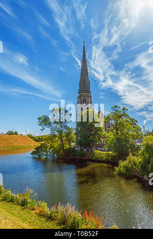 St. Alban's Anglican Church is a traditional English parish church in the Gothic Revival style. Copenhagen. Denmark - Stock Photo