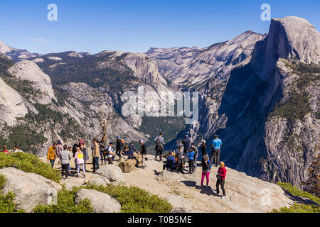 Tourists viewing Half Dome in Yosemite National Park, California - Stock Photo