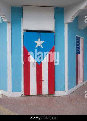 Rincon, Puerto Rico. January 2019. Wooden door with Puerto Rican flag painted on it - Stock Photo