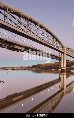 A dusk view of the Tamar Bridges, across the Hamoaze, estuary of the River Tamar, linking Plymouth in Devon and Saltash in Cornwall, Great Britain.