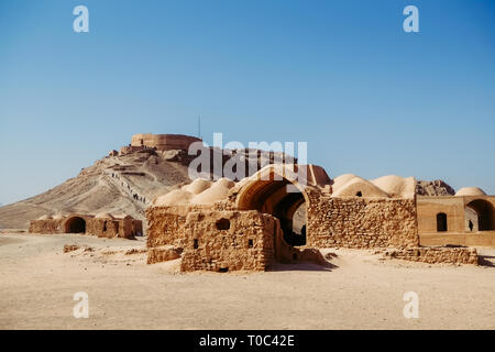 Ruin and ancient buildings in the area of Zoroastrian Dakhma. Persian tower of silence at Yazd, Iran. - Stock Photo