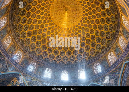 Isfahan, Iran. October 30, 2016 : Sun rays scattered to the rings of ornamental bands forming peacock-like shape. Sheikh Lotfollah Mosque. - Stock Photo