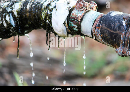 Pipe water leakage, India. - Stock Photo