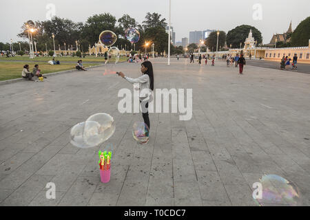 Girl plays with baloons - Stock Photo