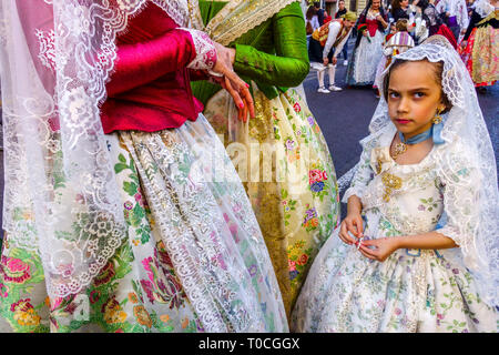 Valencia Fallas, Women in festive folk costumes and girl in parade to the Virgin Mary, Spain - Stock Photo