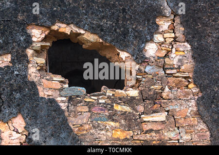 A hole in the brick wall - Stock Photo
