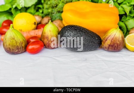 Close up photo of fresh fruit and vegetables on a white background - Stock Photo