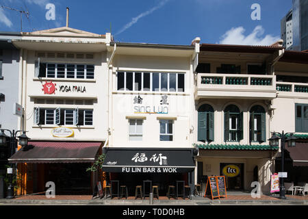 Singapore conserved 3 storey shophouse converted to business along circular road. - Stock Photo