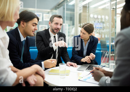 Boss Heading Meeting in Office - Stock Photo
