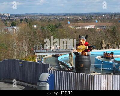 Legoland Windsor Resort UK - Viking's River Splash ride in 'The Land Of The Vikings' section with Windsor Castle on skyline top left - Stock Photo