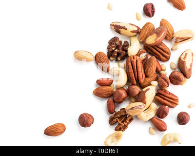Background of nuts - pecan, macadamia, brazil nut, walnut, almonds, hazelnuts, pistachios, cashews, peanuts, pine nuts.Copy space. Isolated one edge on white with clipping path. Top view or flat lay - Stock Photo