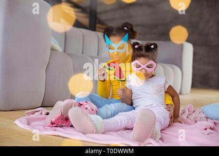 Happy international girls spending holidays with pleasure - Stock Photo