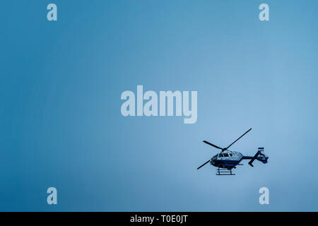 Irish Garda helicopter in the sky on the duty. - Stock Photo
