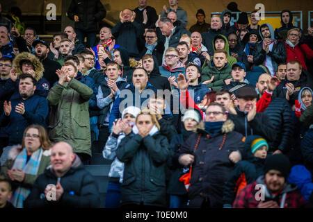 Football fans of English club watching match. - Stock Photo