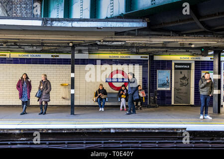 People waiting for a train at Sloane Square underground station , London SW1 - Stock Photo