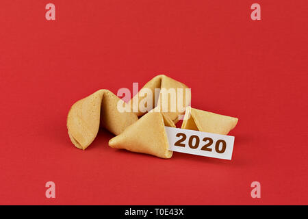 Traditional Chinese new year fortune cookies on red background with white paper and text 2020 - Stock Photo