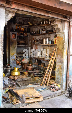 Brass pots & pans stored in old Indian house, Bundi, Rajasthan, India - Stock Photo