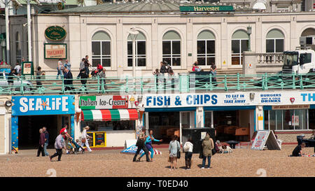 Cafes on the seafront of the seaside town of Brighton, Sussex, England. - Stock Photo