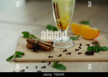 Cup of hot vitamin tea on wooden table. winter hot seasonal drinks. - Stock Photo