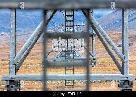Old coal mine tranportation pillars, Longyearbyen, Svalbard, Norway - Stock Photo