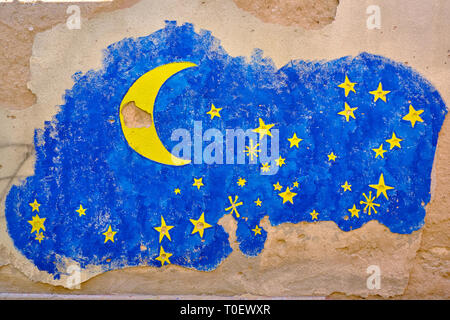 Wall art in Mostar, where the painter used bullet and shrapnel holes as part of design. Starry sky, with stars prior hole - Stock Photo