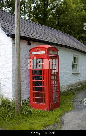 Traditional Red UK Phone Box in a small village in Cwmdu, Carmarthenshire, Wales - Stock Photo