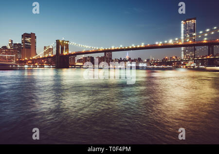 Brooklyn Bridge at blue hour, color toned picture, New York City, USA. - Stock Photo