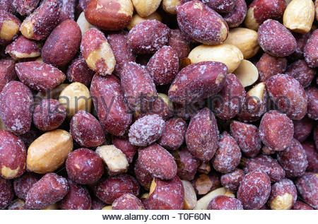 Roasted salted peanuts background. top view. - Stock Photo