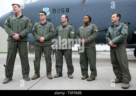 RAF Fairford, Gloucestershire, UK. 19th March 2019. Flight crew from the USAF 2nd Bomb Wing stand in front of a B-52H Stratofortress bomber as RAF Fairford welcomes a Bomber Task Force deployment of six Boeing B-52H Stratofortress aircraft to RAF Fairford from the 2nd Bomb Wing in Louisiana, USA - the largest deployment of B-52s to the UK since Operation Iraqi Freedom in 2003. The aircraft will perform training sorties over The Baltic, Central Europe, the Eastern Mediterranean and Morocco. Credit: Steven May/Alamy Live News - Stock Photo