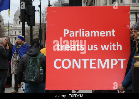 London, UK, UK. 19th Mar, 2019. A Pro-Brexit demonstrator seen holding a placard that says parliament treats us with contempt during the protest outside the Houses of Parliament.The UK will leave the EU on 29 March 2019. Credit: Dinendra Haria/SOPA Images/ZUMA Wire/Alamy Live News - Stock Photo