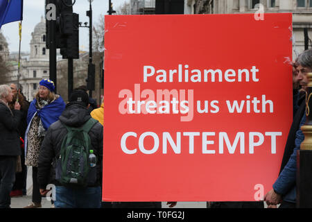A Pro-Brexit demonstrator seen holding a placard that says parliament treats us with contempt during the protest outside the Houses of Parliament. The UK will leave the EU on 29 March 2019. - Stock Photo