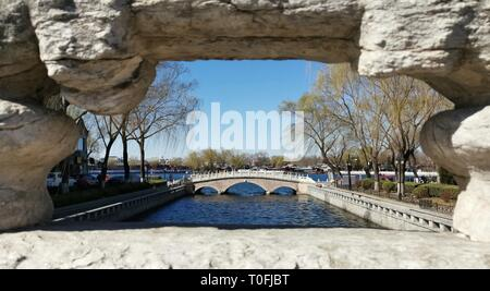 Beijing, China. 12th Mar, 2019. Photo taken with a mobile phone shows the spring scenery at Shichahai area in Beijing, capital of China, March 12, 2019. Credit: Ju Huanzong/Xinhua/Alamy Live News - Stock Photo