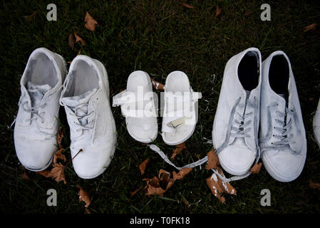 Christchurch, New Zealand. 20th Mar, 2019. A total of 50 pairs of painted white shoes are laid outside the All Soul Church, in memory of the 50 people killed at the mosques shootings in Christchurch, New Zealand, March 20, 2019. Credit: Guo Lei/Xinhua/Alamy Live News - Stock Photo