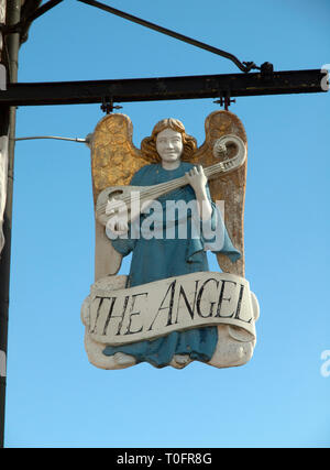 The sign for The Angel pub in the medieval wool town of Lavenham in Suffolk - Stock Photo