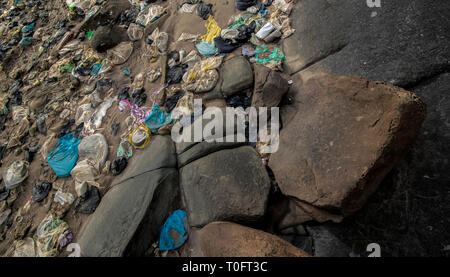 A build up of plastic waste washed up from the South China Sea. Photographed here on the Malaysian coastline of Borneo. - Stock Photo