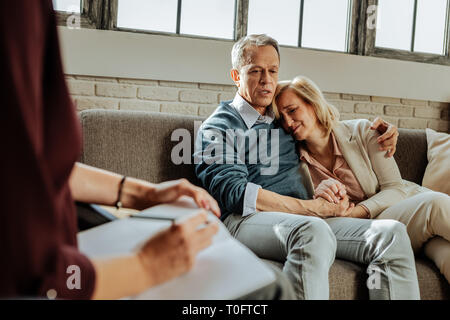 Desperate good-looking couple having crises in their relationship - Stock Photo