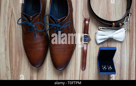Wedding details, groom casual outfits flat lay on wooden background - Stock Photo