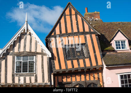 15th century Crooked House antiques shop and tearooms in quaint wonky crooked orange timbered building in High Street, Lavenham, Suffolk, England, UK. - Stock Photo