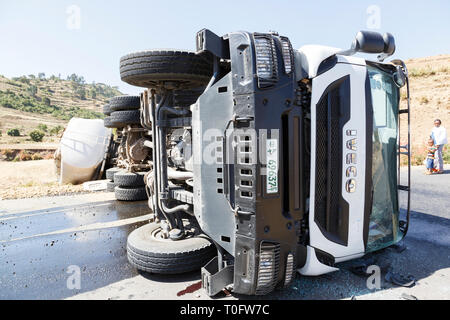 Addis Abeba, Ethiopia, January 15 2015: Accident on a country road with a diesel tanker truck overturned in a curve - Stock Photo