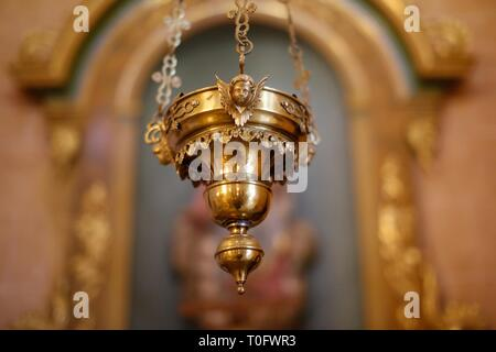 Close up of a Thurible Catholic incense burner hanging in a Spanish church - Stock Photo