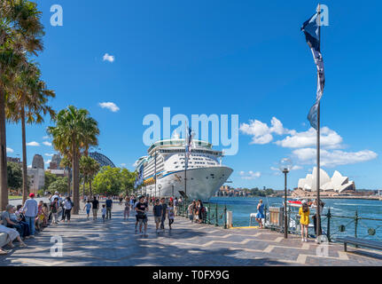 Circular Quay, Sydney. Explorer of the Seas cruise ship with Sydney Harbour Bridge to the left and Sydney Opera House to the right, Sydney, Australia - Stock Photo