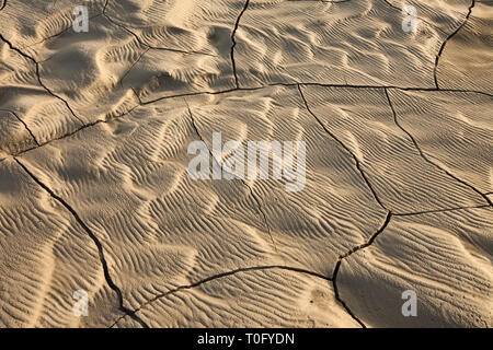 Cracked earth in dry riverbed Landmannalaugar, Iceland - Stock Photo